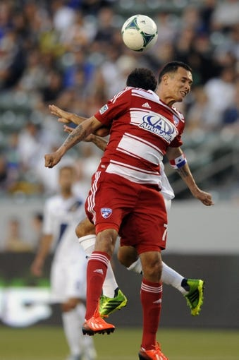 Jul 7, 2013; Carson, CA, USA; FC Dallas forward Blas P  rez (7) jumps up for the header against the Los Angeles Galaxy during the first half at the StubHub Center. Mandatory Credit: Kelvin Kuo-USA TODAY Sports