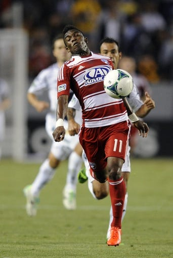 Jul 7, 2013; Carson, CA, USA; FC Dallas forward Fabian Castillo (11) receives a pass during the game against the Los Angeles Galaxy during the first half at the StubHub Center. Mandatory Credit: Kelvin Kuo-USA TODAY Sports