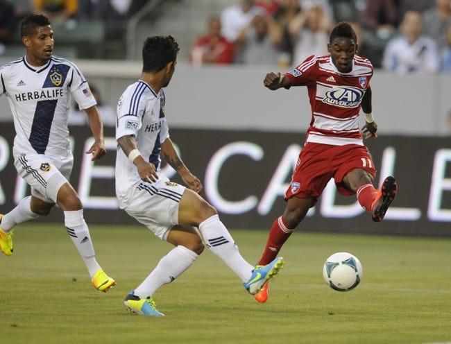 Jul 7, 2013; Carson, CA, USA; FC Dallas forward Fabian Castillo (11) attempts a shot defended by Los Angeles Galaxy defender A.J. DeLaGarza (20) during the first half at the StubHub Center. Mandatory Credit: Kelvin Kuo-USA TODAY Sports