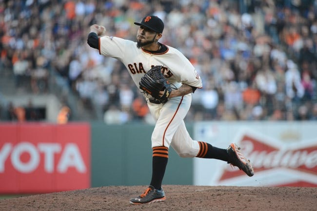 July 6, 2013; San Francisco, CA, USA; San Francisco Giants relief pitcher Sergio Romo (54) delivers a pitch against the Los Angeles Dodgers during the ninth inning at AT&T Park. The Giants defeated the Dodgers 4-2. Mandatory Credit: Kyle Terada-USA TODAY Sports