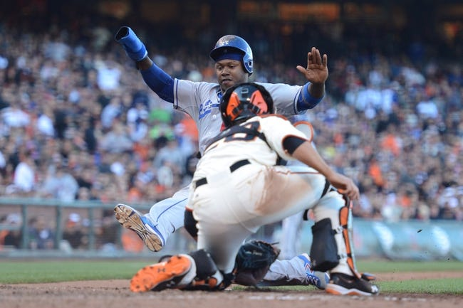 July 6, 2013; San Francisco, CA, USA; San Francisco Giants catcher Buster Posey (28, front) tags out Los Angeles Dodgers shortstop Hanley Ramirez (13, back) during the seventh inning at AT&T Park. The Giants defeated the Dodgers 4-2. Mandatory Credit: Kyle Terada-USA TODAY Sports