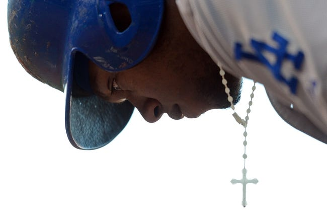 July 6, 2013; San Francisco, CA, USA; Close-up view of Los Angeles Dodgers shortstop Hanley Ramirez (13) and his cross necklace as he prepares on deck during the ninth inning against the San Francisco Giants at AT&T Park. The Giants defeated the Dodgers 4-2. Mandatory Credit: Kyle Terada-USA TODAY Sports
