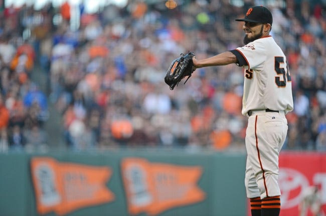 July 6, 2013; San Francisco, CA, USA; San Francisco Giants relief pitcher Sergio Romo (54) smiles against the Los Angeles Dodgers during the ninth inning at AT&T Park. The Giants defeated the Dodgers 4-2. Mandatory Credit: Kyle Terada-USA TODAY Sports