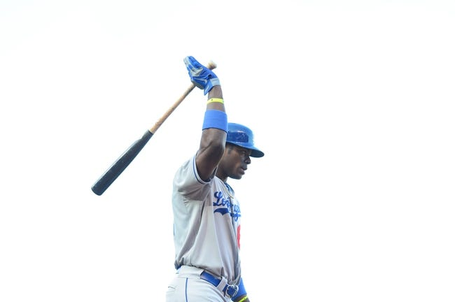 July 6, 2013; San Francisco, CA, USA; Los Angeles Dodgers right fielder Yasiel Puig (66) walks to the dugout after striking out against the San Francisco Giants during the sixth inning at AT&T Park. The Giants defeated the Dodgers 4-2. Mandatory Credit: Kyle Terada-USA TODAY Sports