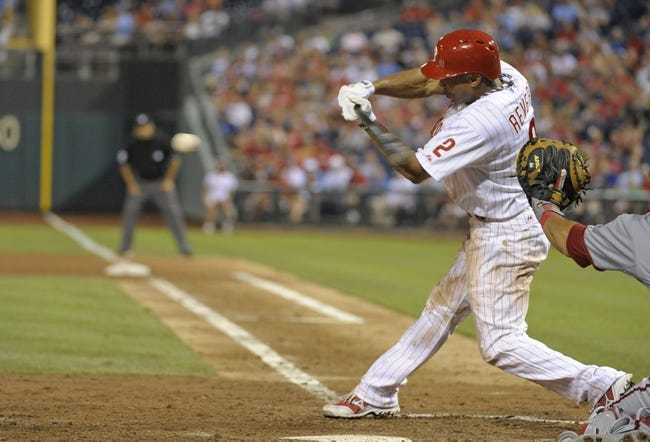 Jul 8, 2013; Philadelphia, PA, USA; Philadelphia Phillies center fielder Ben Revere (2) hits a double in the 6th inning against the Washington Nationals at Citizens Bank Park. Mandatory Credit: Eric Hartline-USA TODAY Sports