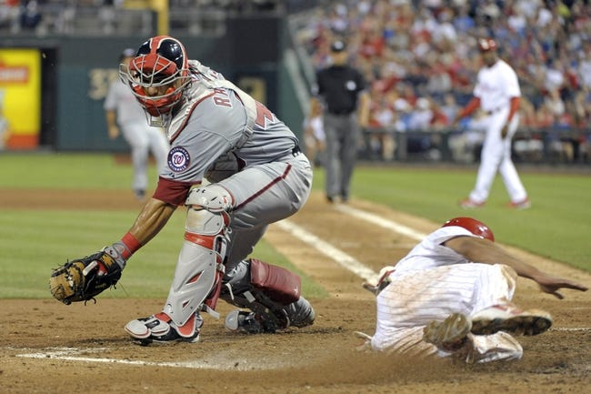 Jul 8, 2013; Philadelphia, PA, USA; Philadelphia Phillies center fielder Ben Revere (2) slides safely into home ahead of tag by Washington Nationals catcher Wilson Ramos (40) in the sixth inning at Citizens Bank Park. Mandatory Credit: Eric Hartline-USA TODAY Sports