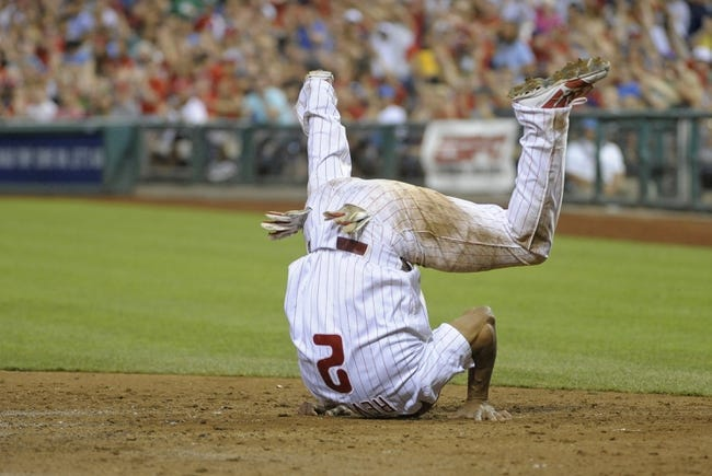 Jul 8, 2013; Philadelphia, PA, USA; Philadelphia Phillies center fielder Ben Revere (2) slides safely into home against the Washington Nationals in the sixth inning at Citizens Bank Park. Mandatory Credit: Eric Hartline-USA TODAY Sports