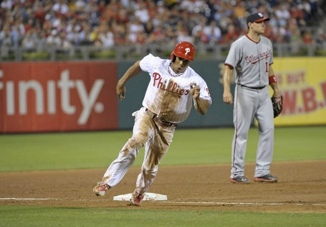 Jul 8, 2013; Philadelphia, PA, USA; Philadelphia Phillies center fielder Ben Revere (2) rounds third base against the Washington Nationals in the sixth inning at Citizens Bank Park. Mandatory Credit: Eric Hartline-USA TODAY Sports