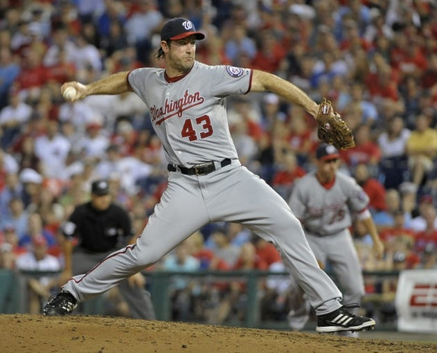 Jul 8, 2013; Philadelphia, PA, USA; Washington Nationals relief pitcher Ross Ohlendorf (43) pitches in the eighth inning against the Philadelphia Phillies at Citizens Bank Park. The Phillies defeated the Nationals, 3-2. Mandatory Credit: Eric Hartline-USA TODAY Sports