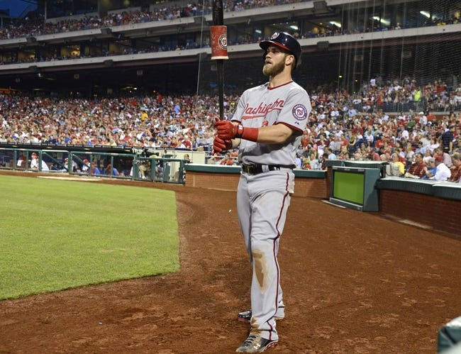 Jul 8, 2013; Philadelphia, PA, USA; Washington Nationals left fielder Bryce Harper (34) waits on deck in the sixth inning against the Philadelphia Phillies at Citizens Bank Park. The Phillies defeated the Nationals, 3-2. Mandatory Credit: Eric Hartline-USA TODAY Sports