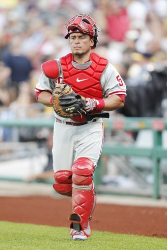 Jul 2, 2013; Pittsburgh, PA, USA; Philadelphia Phillies catcher Carlos Ruiz (51) leaves the dugout to start the inning against the Pittsburgh Pirates during the second inning at PNC Park. The Philadelphia Phillies won 3-1. Mandatory Credit: Charles LeClaire-USA TODAY Sports