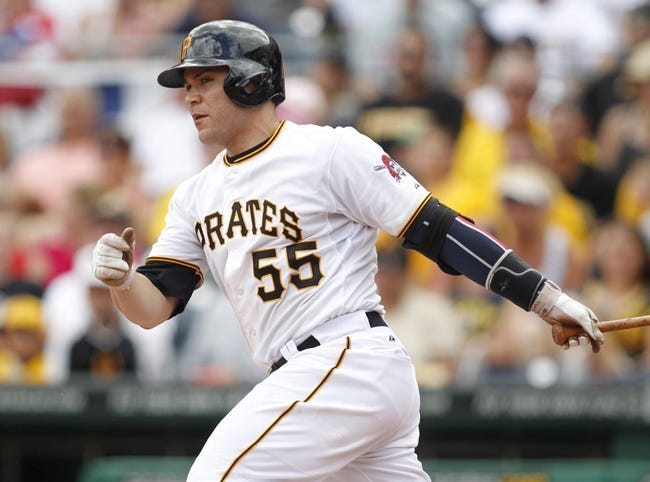 Jul 4, 2013; Pittsburgh, PA, USA; Pittsburgh Pirates catcher Russell Martin (55) at bat against the Philadelphia Phillies during the fourth inning at PNC Park. The Philadelphia Phillies won 6-4.Mandatory Credit: Charles LeClaire-USA TODAY Sports