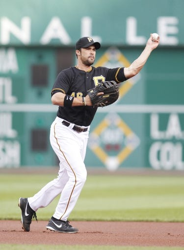 Jul 2, 2013; Pittsburgh, PA, USA; Pittsburgh Pirates first baseman Garrett Jones (46) throws to first base against the Philadelphia Phillies during the first inning at PNC Park. The Philadelphia Phillies won 3-1. Mandatory Credit: Charles LeClaire-USA TODAY Sports