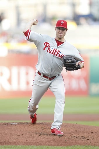 Jul 2, 2013; Pittsburgh, PA, USA; Philadelphia Phillies starting pitcher Jonathan Pettibone (44) delivers a pitch against the Pittsburgh Pirates during the first inning at PNC Park. The Philadelphia Phillies won 3-1. Mandatory Credit: Charles LeClaire-USA TODAY Sports