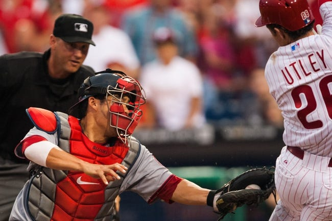 Jul 9, 2013; Philadelphia, PA, USA; Washington Nationals catcher Kurt Suzuki (24) goes to tag Philadelphia Phillies second baseman Chase Utley (26) during the fourth inning at Citizens Bank Park. Mandatory Credit: Howard Smith-USA TODAY Sports
