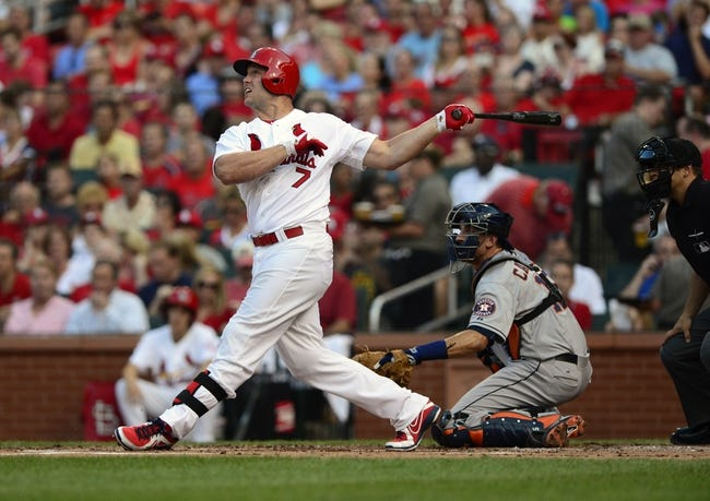 Jul 9, 2013; St. Louis, MO, USA; St. Louis Cardinals left fielder Matt Holliday (7) hits a two run home run off of Houston Astros starting pitcher Bud Norris (not pictured) during the first inning at Busch Stadium. Mandatory Credit: Jeff Curry-USA TODAY Sports