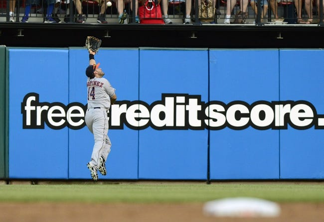 Jul 9, 2013; St. Louis, MO, USA; Houston Astros right fielder J.D. Martinez (14) jumps unsuccessfully for a ball hit by St. Louis Cardinals shortstop Daniel Descalso (not pictured) during the second inning at Busch Stadium. Mandatory Credit: Jeff Curry-USA TODAY Sports