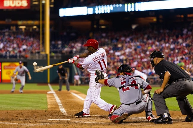Jul 9, 2013; Philadelphia, PA, USA; Philadelphia Phillies shortstop Jimmy Rollins (11) singles during the sixth inning against the Washington Nationals at Citizens Bank Park. The Phillies defeated the Nationals 4-2. Mandatory Credit: Howard Smith-USA TODAY Sports
