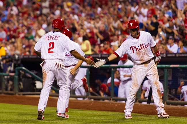 Jul 9, 2013; Philadelphia, PA, USA; Philadelphia Phillies center fielder Ben Revere (2) celebrates scoring with third baseman Michael Young (10) during the sixth inning against the Washington Nationals at Citizens Bank Park. The Phillies defeated the Nationals 4-2. Mandatory Credit: Howard Smith-USA TODAY Sports