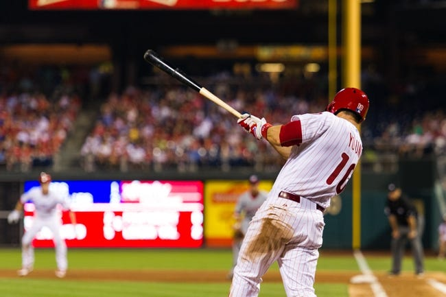 Jul 9, 2013; Philadelphia, PA, USA; Philadelphia Phillies third baseman Michael Young (10) hits a two RBI double during the sixth inning against the Washington Nationals at Citizens Bank Park. The Phillies defeated the Nationals 4-2. Mandatory Credit: Howard Smith-USA TODAY Sports