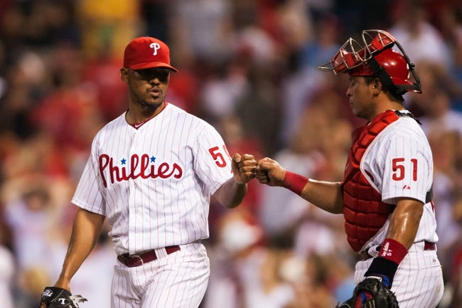 Jul 9, 2013; Philadelphia, PA, USA; Philadelphia Phillies pitcher Antonio Bastardo (59) celebrates with catcher Carlos Ruiz (51) after getting the last out during the ninth inning against the Washington Nationals at Citizens Bank Park. The Phillies defeated the Nationals 4-2. Mandatory Credit: Howard Smith-USA TODAY Sports
