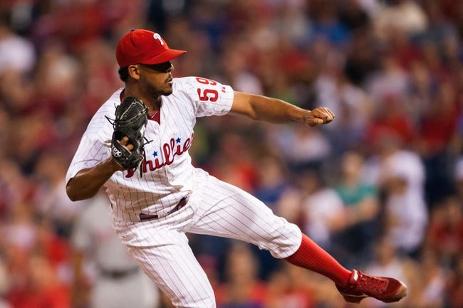 Jul 9, 2013; Philadelphia, PA, USA; Philadelphia Phillies pitcher Antonio Bastardo (59) delivers to the plate during the ninth inning against the Washington Nationals at Citizens Bank Park. The Phillies defeated the Nationals 4-2. Mandatory Credit: Howard Smith-USA TODAY Sports