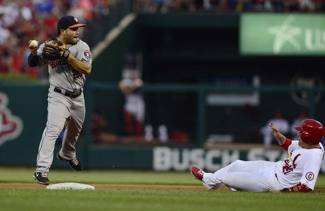 Jul 9, 2013; St. Louis, MO, USA; Houston Astros second baseman Jose Altuve (27) turns a double play as St. Louis Cardinals first baseman Allen Craig (21) slides during the third inning at Busch Stadium. Mandatory Credit: Jeff Curry-USA TODAY Sports