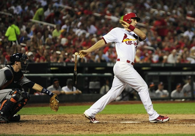 Jul 9, 2013; St. Louis, MO, USA; St. Louis Cardinals second baseman Matt Carpenter (13) hits a two run double off of Houston Astros starting pitcher Bud Norris (not pictured) during the fourth inning at Busch Stadium. Mandatory Credit: Jeff Curry-USA TODAY Sports