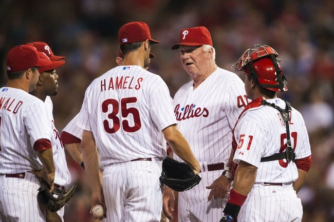 Jul 9, 2013; Philadelphia, PA, USA; Philadelphia Phillies manager Charlie Manuel (41) talks with pitcher Cole Hamels (35) during the eighth inning against the Washington Nationals at Citizens Bank Park. The Phillies defeated the Nationals 4-2. Mandatory Credit: Howard Smith-USA TODAY Sports