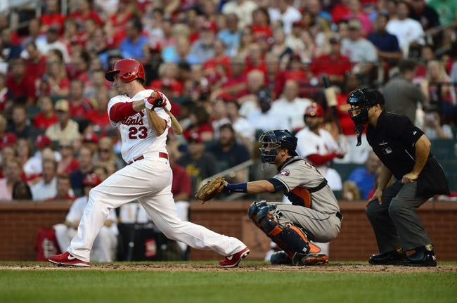 Jul 9, 2013; St. Louis, MO, USA; St. Louis Cardinals third baseman David Freese (23) hits a single off of Houston Astros starting pitcher Bud Norris (not pictured) during the second inning at Busch Stadium. Mandatory Credit: Jeff Curry-USA TODAY Sports