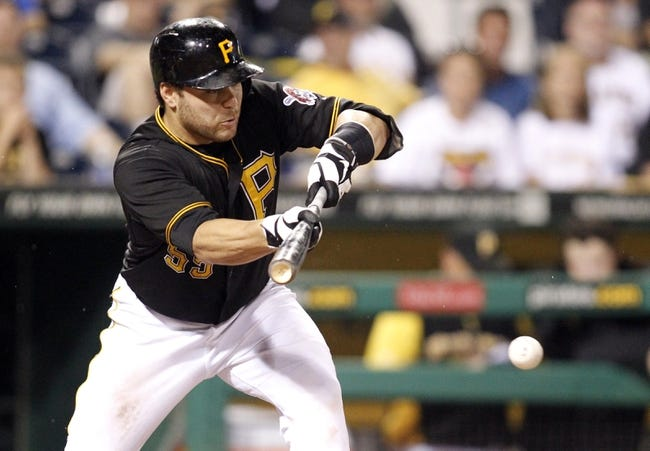 Jul 9, 2013; Pittsburgh, PA, USA; Pittsburgh Pirates catcher Russell Martin (55) hits a sacrifice bunt against the Oakland Athletics during the seventh inning at PNC Park. The Oakland Athletics won 2-1. Mandatory Credit: Charles LeClaire-USA TODAY Sports