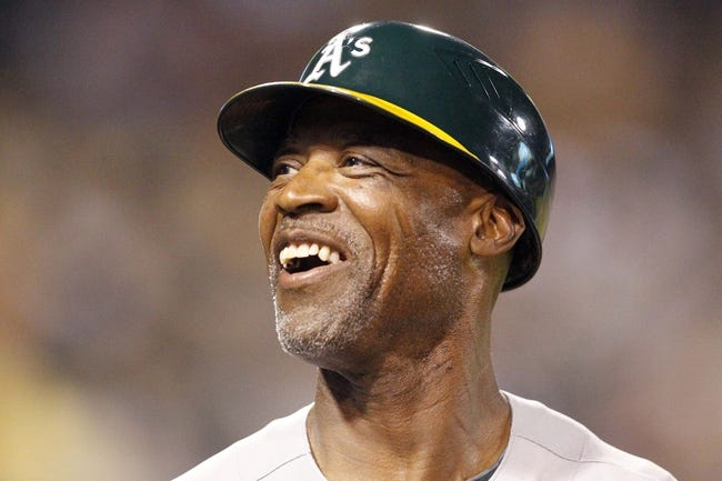 Jul 9, 2013; Pittsburgh, PA, USA; Oakland Athletics first base coach Tye Waller (46) reacts on the field against the Pittsburgh Pirates during the eighth inning at PNC Park. The Oakland Athletics won 2-1. Mandatory Credit: Charles LeClaire-USA TODAY Sports