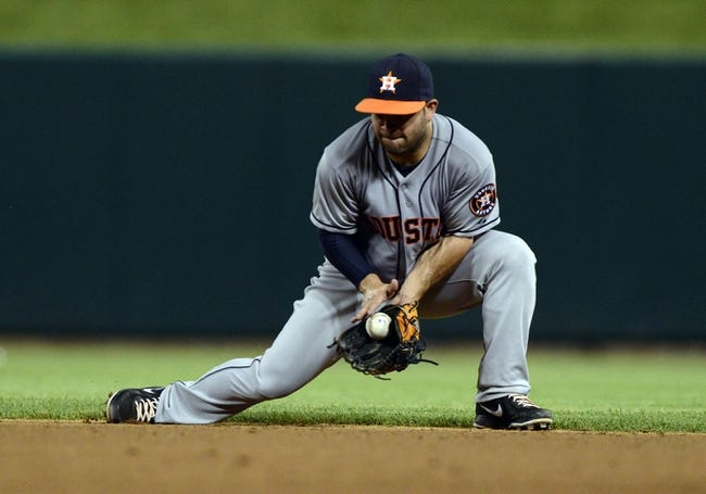 Jul 9, 2013; St. Louis, MO, USA; Houston Astros second baseman Jose Altuve (27) fields a ground ball hit by St. Louis Cardinals center fielder Jon Jay (not pictured) during the seventh inning at Busch Stadium. St. Louis defeated Houston 9-5. Mandatory Credit: Jeff Curry-USA TODAY Sports