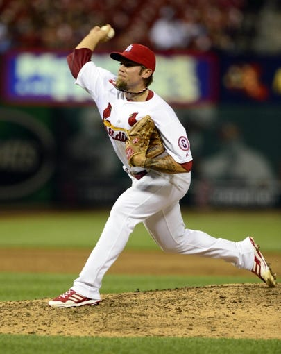 Jul 9, 2013; St. Louis, MO, USA; St. Louis Cardinals relief pitcher Michael Blazek (67) throws to a Houston Astros batter during the ninth inning at Busch Stadium. St. Louis defeated Houston 9-5. Mandatory Credit: Jeff Curry-USA TODAY Sports