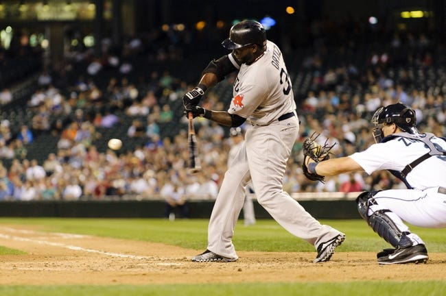 Jul 9, 2013; Seattle, WA, USA; Boston Red Sox designated hitter David Ortiz (34) hits a double against the Seattle Mariners during the 6th inning at Safeco Field. Mandatory Credit: Steven Bisig-USA TODAY Sports