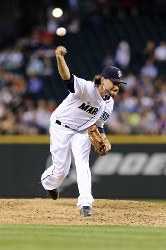 Jul 9, 2013; Seattle, WA, USA; Seattle Mariners relief pitcher Danny Farquhar (40) pitches to the Boston Red Sox during the 6th inning at Safeco Field. Mandatory Credit: Steven Bisig-USA TODAY Sports
