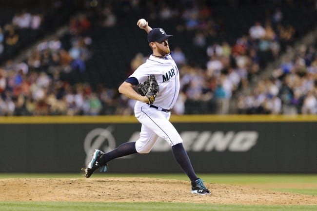 Jul 9, 2013; Seattle, WA, USA; Seattle Mariners relief pitcher Charlie Furbush (41) pitches to the Boston Red Sox during the 6th inning at Safeco Field. Mandatory Credit: Steven Bisig-USA TODAY Sports