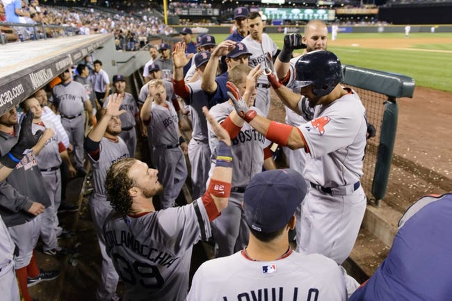 Jul 9, 2013; Seattle, WA, USA; Boston Red Sox right fielder Shane Victorino (18) celebrates with teammates after hitting a solo home run against the Seattle Mariners during the 8th inning at Safeco Field. Mandatory Credit: Steven Bisig-USA TODAY Sports
