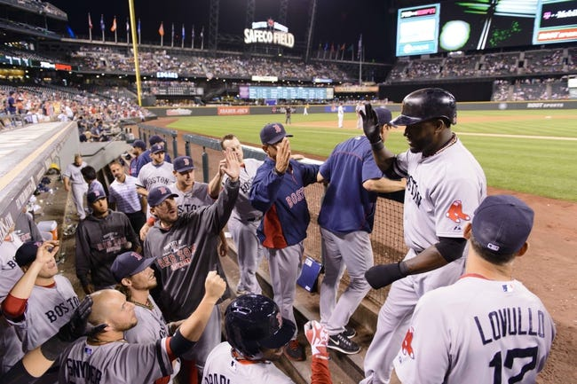 Jul 9, 2013; Seattle, WA, USA; Boston Red Sox designated hitter David Ortiz (34) celebrates with teammates after scoring a run off a single hit by Boston Red Sox shortstop Jose Iglesias (10) (not pictured) during the 8th inning at Safeco Field. Mandatory Credit: Steven Bisig-USA TODAY Sports