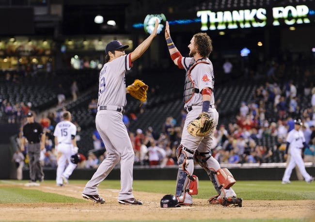 Jul 9, 2013; Seattle, WA, USA; Boston Red Sox relief pitcher Koji Uehara (19) and Boston Red Sox catcher Jarrod Saltalamacchia (39) high-five after the final out against the Seattle Mariners at Safeco Field. Boston defeated Seattle 11-8. Mandatory Credit: Steven Bisig-USA TODAY Sports