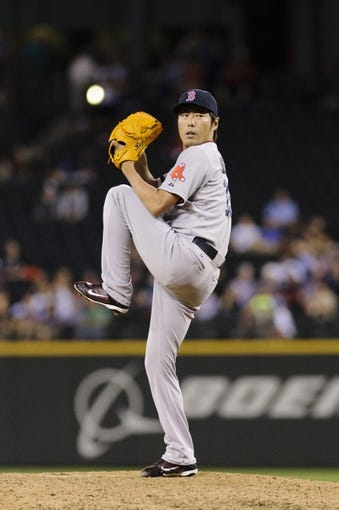 Jul 9, 2013; Seattle, WA, USA; Boston Red Sox relief pitcher Koji Uehara (19) pitches to the Seattle Mariners during the 9th inning at Safeco Field. Boston defeated Seattle 11-8. Mandatory Credit: Steven Bisig-USA TODAY Sports