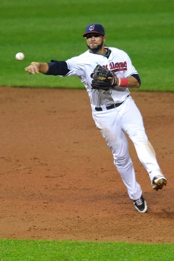 Jul 8, 2013; Cleveland, OH, USA; Cleveland Indians shortstop Mike Aviles (4) during a game against the Detroit Tigers at Progressive Field. Detroit won 4-2. Mandatory Credit: David Richard-USA TODAY Sports