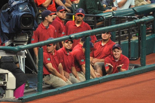 Jul 8, 2013; Cleveland, OH, USA; The Cleveland Indians grounds crew sits in the camera bay during a game between the Cleveland Indians and the Detroit Tigers at Progressive Field. Detroit won 4-2. Mandatory Credit: David Richard-USA TODAY Sports