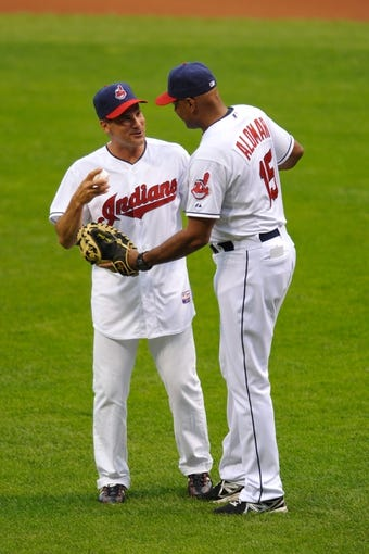 Jul 8, 2013; Cleveland, OH, USA; Cleveland Indians former shortstop Omar Vizquel and Cleveland Indians bench coach Sandy Alomar, Jr. (15) before a game against the Detroit Tigers at Progressive Field. Detroit won 4-2. Mandatory Credit: David Richard-USA TODAY Sports