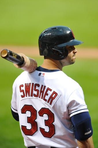 Jul 8, 2013; Cleveland, OH, USA; Cleveland Indians first baseman Nick Swisher (33) during a game against the Detroit Tigers at Progressive Field. Detroit won 4-2. Mandatory Credit: David Richard-USA TODAY Sports