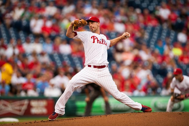 Jul 10, 2013; Philadelphia, PA, USA; Philadelphia Phillies pitcher Cliff Lee (33) delivers to the plate during the first inning against the Washington Nationals at Citizens Bank Park. Mandatory Credit: Howard Smith-USA TODAY Sports