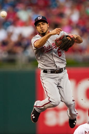 Jul 10, 2013; Philadelphia, PA, USA; Washington Nationals second baseman Anthony Rendon (6) throws to first base to complete the double play after forcing Philadelphia Phillies center fielder Ben Revere (2) at second base during the first inning at Citizens Bank Park. Mandatory Credit: Howard Smith-USA TODAY Sports