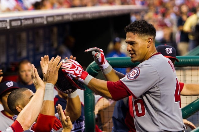 Jul 10, 2013; Philadelphia, PA, USA; Washington Nationals catcher Wilson Ramos (40) celebrates hitting a home run with teammates during the fifth inning against the Philadelphia Phillies at Citizens Bank Park. Mandatory Credit: Howard Smith-USA TODAY Sports