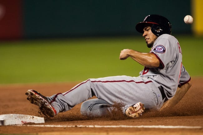 Jul 10, 2013; Philadelphia, PA, USA; Washington Nationals second baseman Anthony Rendon (6) advances to third base during the ninth inning against the Philadelphia Phillies at Citizens Bank Park. The Nationals defeated the Phillies 5-1. Mandatory Credit: Howard Smith-USA TODAY Sports