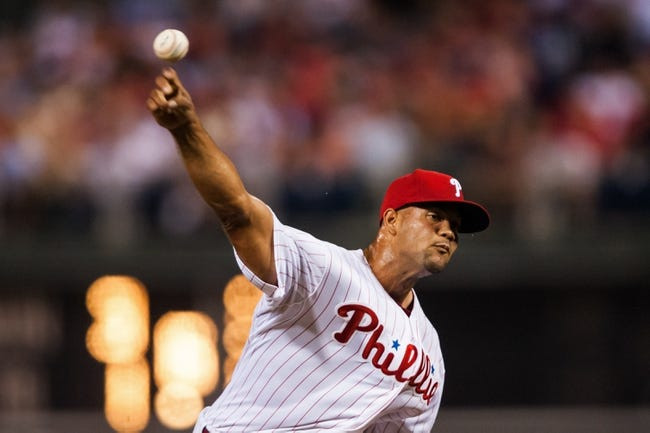 Jul 10, 2013; Philadelphia, PA, USA; Philadelphia Phillies pitcher Luis Garcis (57) delivers to the plate during the eighth inning against the Washington Nationals at Citizens Bank Park. The Nationals defeated the Phillies 5-1. Mandatory Credit: Howard Smith-USA TODAY Sports